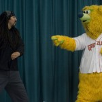 Fresno Grizzlies mascot Parker gets a school employee excited about the Grizzlies' Wild About Reading program.