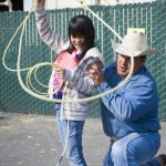 A young student learns to rope cattle at the 2012 Farm & Nutrition Day.