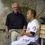 Fresno Grizzlies President Chris Cummings (left) has a discussion with Grizzlies pitcher Yusmeiro Petit in the dugout during Thursday night's game.